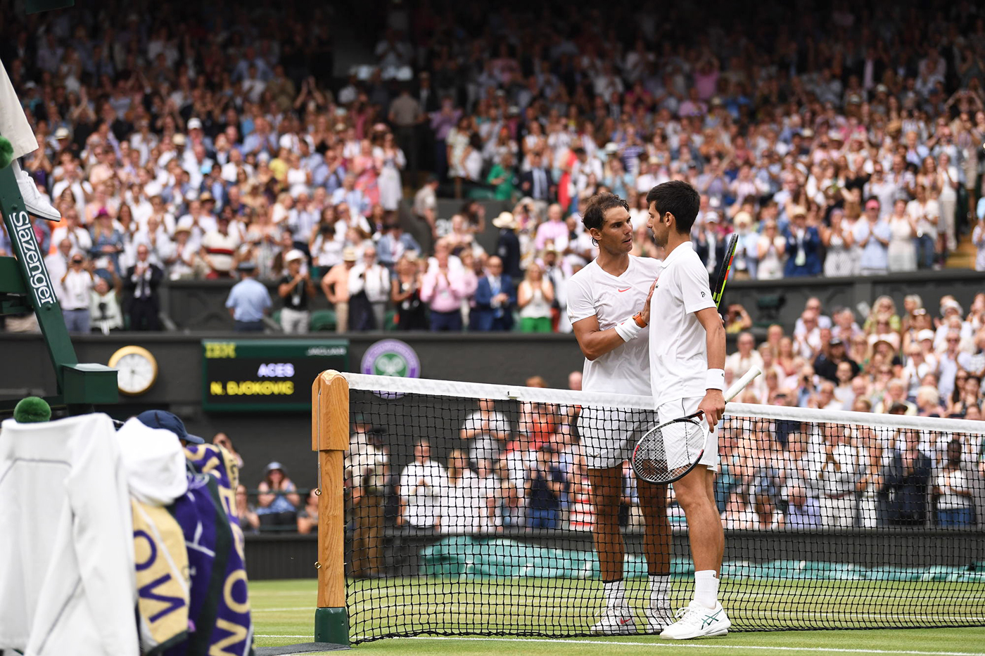 Novak Djokovic SRB v Rafael Nadal ESP in the semi final of the Gentlemen's Singles on Centre Court. The Championships 2018. Held at The All England Lawn Tennis Club, Wimbledon. Day 12 Saturday 14/07/2018. Credit: AELTC/Ben Solomon
