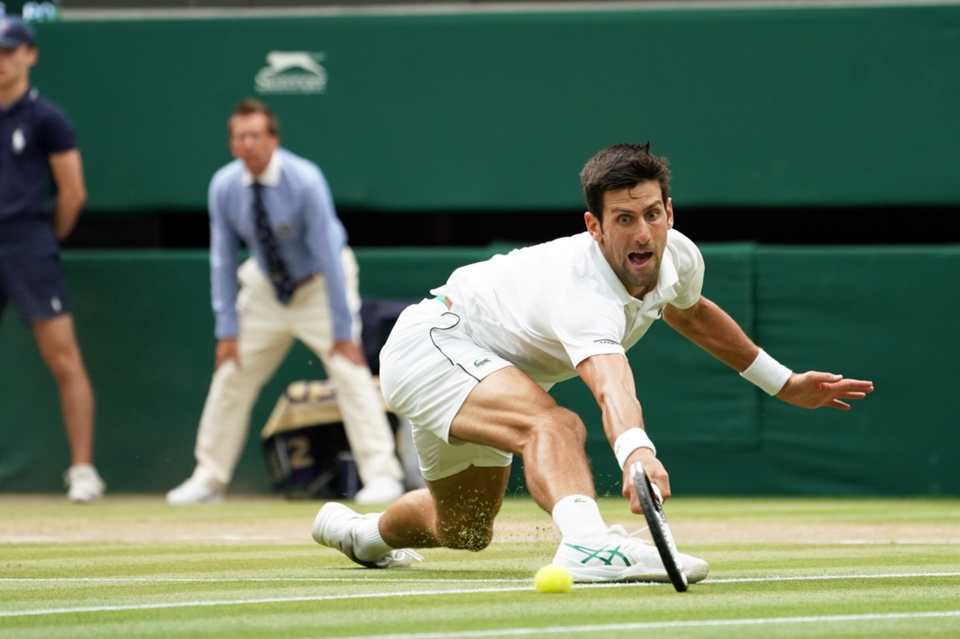 Novak Djokovic SRB v Rafael Nadal ESP in the semi final of the Gentlemen's Singles on Centre Court. The Championships 2018. Held at The All England Lawn Tennis Club, Wimbledon. Day 12 Saturday 14/07/2018. Credit: AELTC/Bob Martin